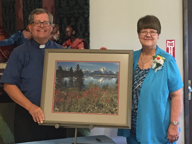 Scott and Cindy Jorgenson with the church's gift.png